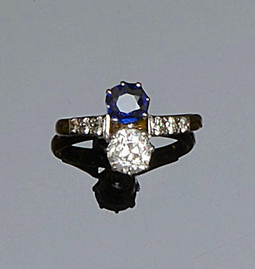 A sapphire and diamond two stone ring