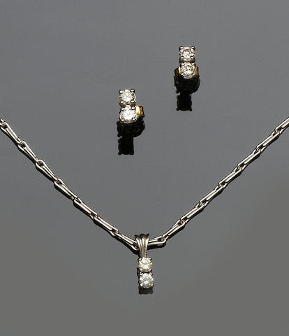 A diamond pendant and a matched pair of earstuds ensuite (2)