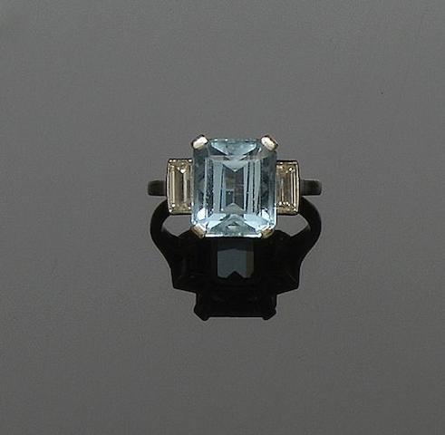 An aquamarine and diamond three stone ring