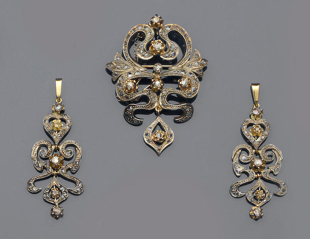 A diamond set brooch/pendant and pair of earpendants ensuite (2)