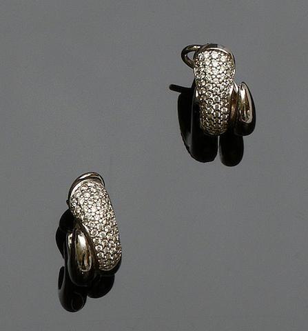A pair of diamond set ear hoops