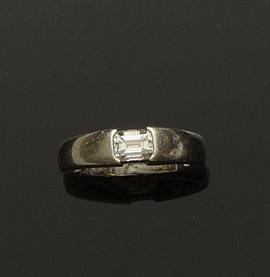 A platinum and diamond single stone ring