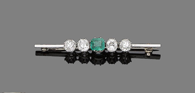 An emerald and diamond bar brooch