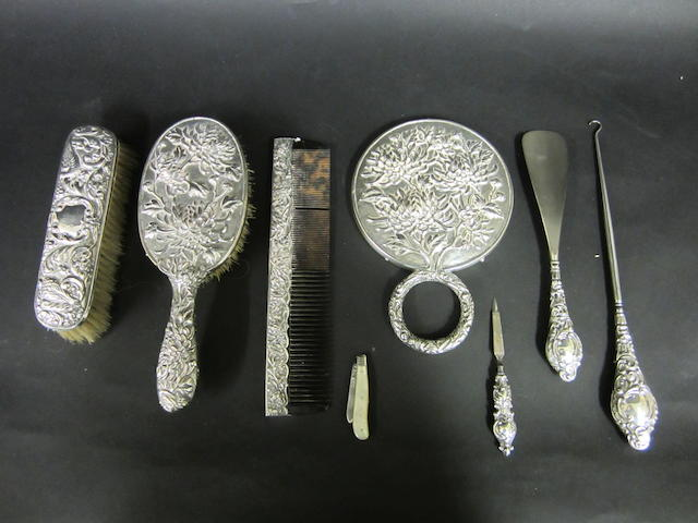 A collection of silver dressing table set