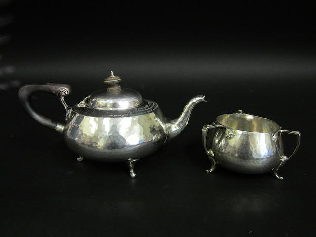 An Arts and Crafts silver spot-hammered teapot By Connel of London, London 1913  (2)