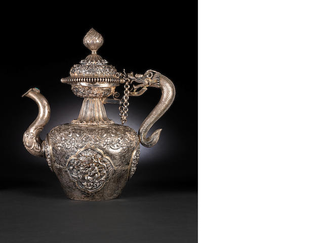 A Tibetan white metal repuossé teapot 18th or 19th century