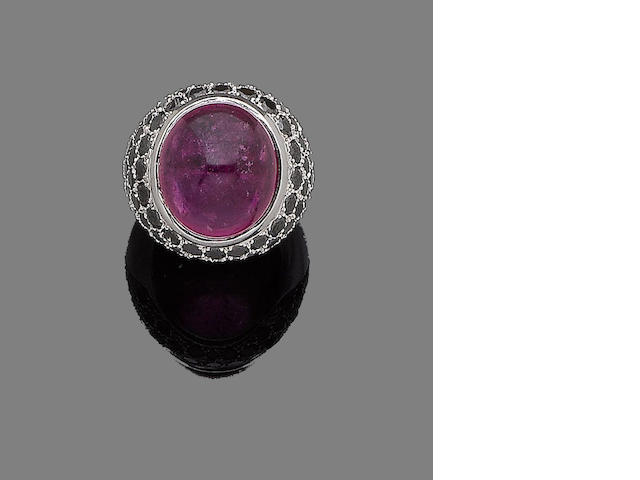 A tourmaline and black diamond dress ring