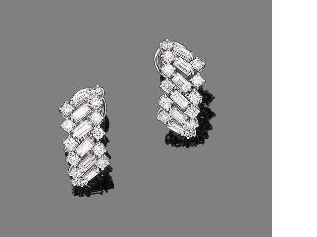 A pair of diamond earrings,