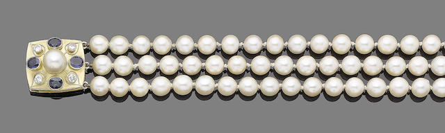 A three-strand cultured pearl necklace