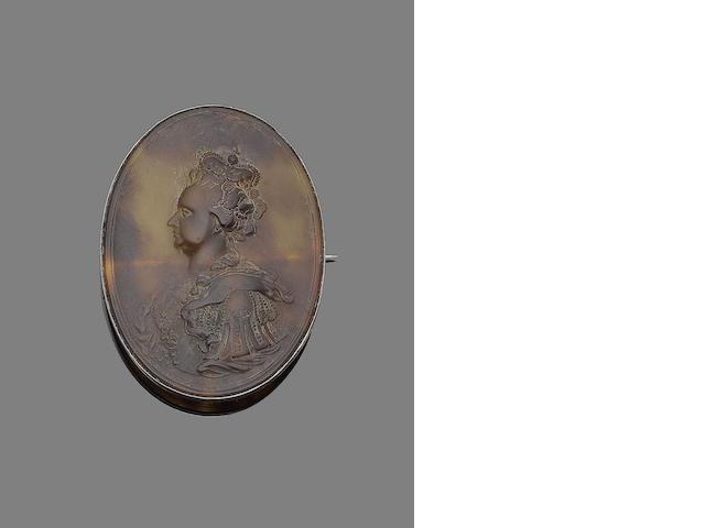 A tortoiseshell cameo brooch,  by John Obvisset,