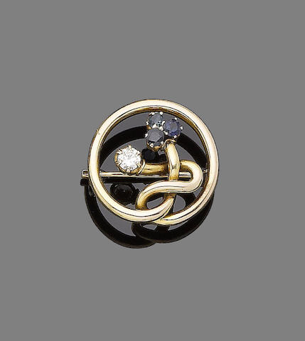 A sapphire and diamond-set brooch