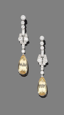A pair of topaz and diamond pendent earrings