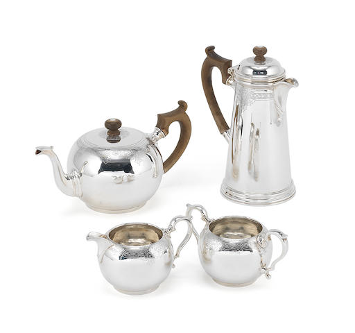 A modern silver four-piece tea service