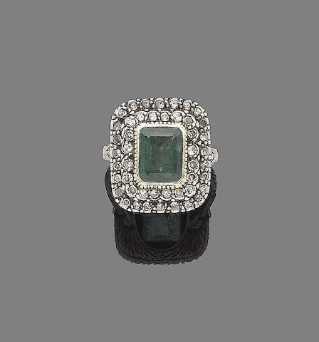A late 19th century emerald and diamond cluster ring