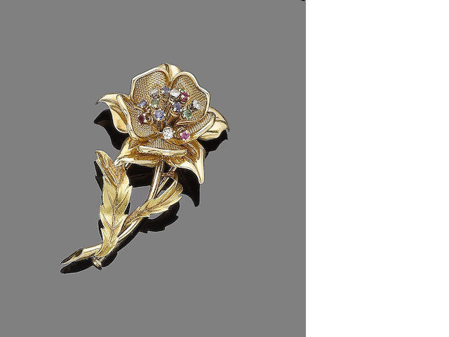 A gem-set flower brooch