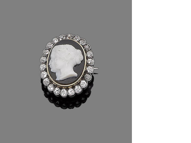 An onyx cameo and diamond brooch,