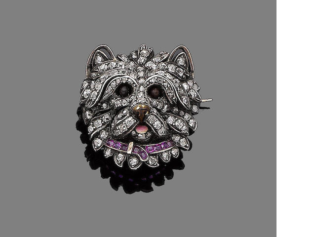 A ruby, enamel and diamond dog's head brooch/pendant,