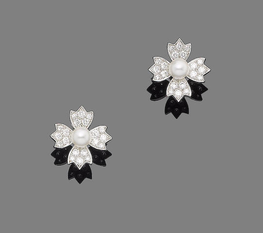 A pair of cultured pearl and diamond earrings, by Tiffany & Co,