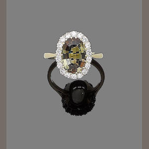 An andalusite and diamond cluster ring,