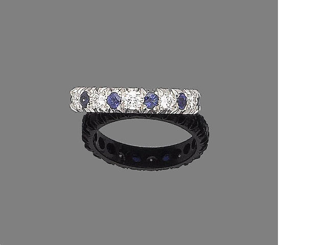 A sapphire and diamond eternity ring,