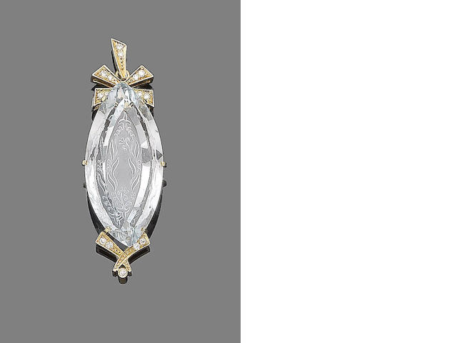 A carved aquamarine and diamond pendant