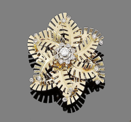 A diamond snowflake brooch