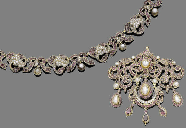 A silver gilt, pearl and garnet necklace and pendant, (2)