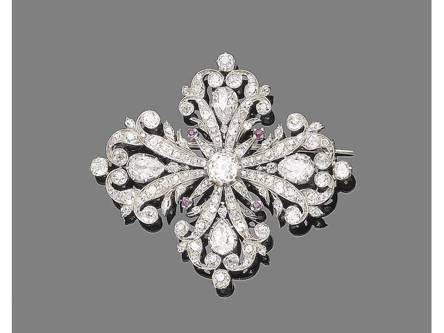 An early 20th century ruby and diamond cross brooch