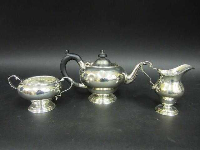 A silver three piece tea service London 1935