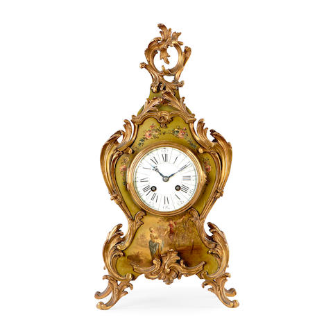 A late 19th century painted wood and gilt metal mounted mantel clock