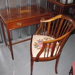 An Edwardian mahogany marquetry side table and an armchair