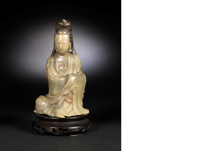 A stained soapstone carving of Guanyin Qign Dynasty or later