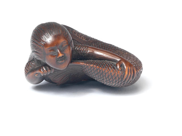 A wood netsuke of a mermaid By Tadatoshi (c.1770-1840), Nagoya, 19th century