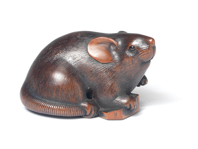 A wood netsuke of a rat  By Ikkan, Nagoya, 19th century