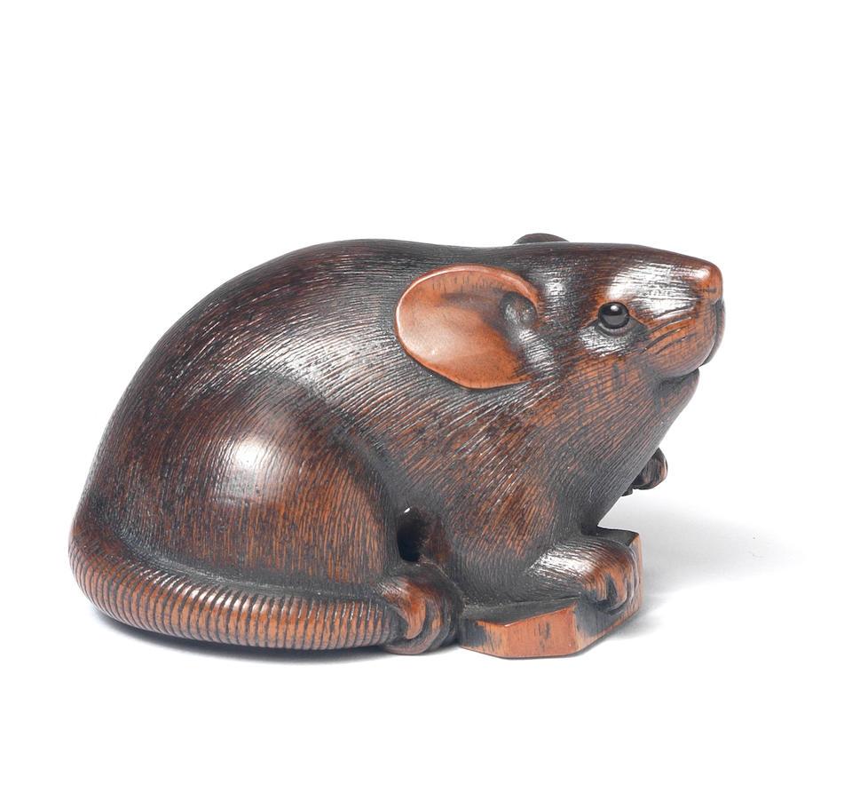 A wood netsuke of a rat By Ikkan, Nagoya, 19th century