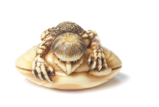 An ivory netsuke of a kappa on a clam By Rensai, late 19th century