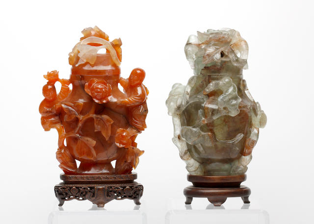 A carved carnelian figure group and a carved green quartz figure group