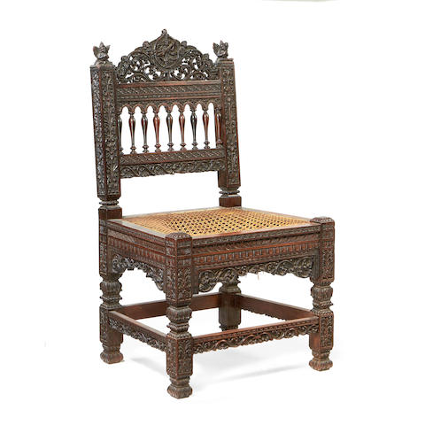 An Indian 19th century carved rosewood low chair