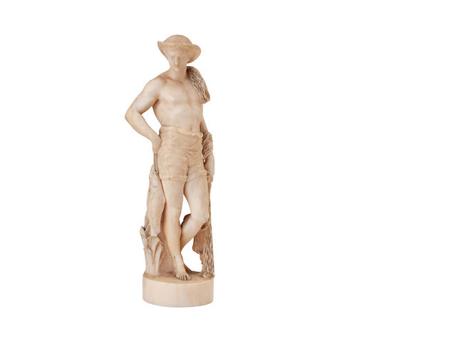 A carved ivory figure of a fisherman