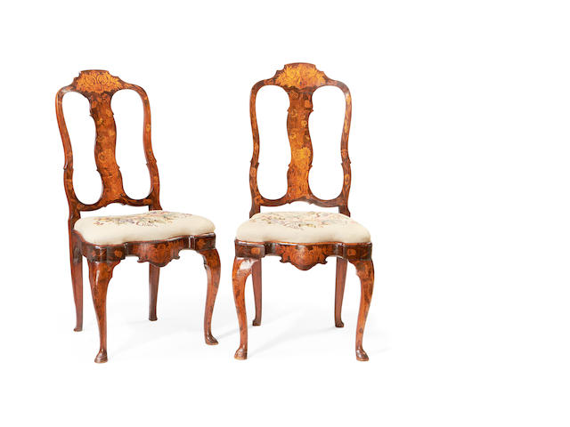 A set of six Dutch 18th century walnut, elm and fruitwood marquetry dining chairs
