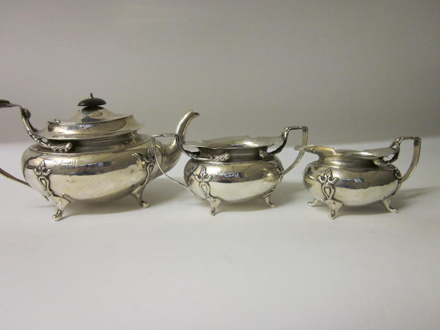 A silver three piece tea service by Goldsmith and Silversmith Co., London 1906, marks rubbed  (3)