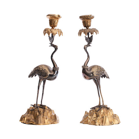 A pair of silvered and gilt candlesticks