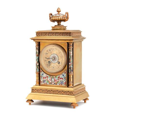 A late Victorian brass champleve enamel mantel clock