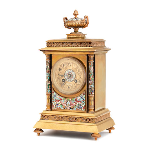A late Victorian brass champleve enamel mantel clock
