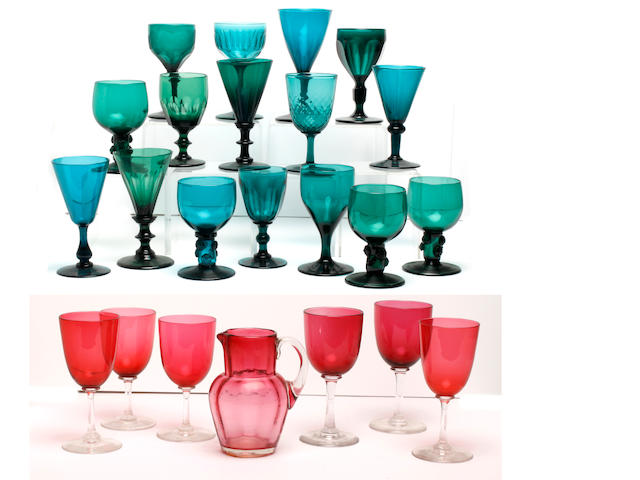 A collection of twenty-eight green-tinted wine glasses, 19th and early 20th century