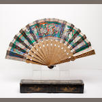 A Chinese export carved sandalwood fan