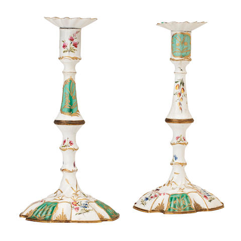 A pair of 18th century Battersea enamel candelsticks