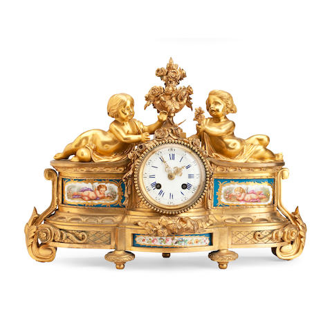 A French ormolu mounted and Sèvres pattern porcelain mantel clock
