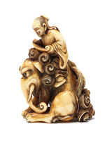 A rare ivory netsuke of Roshi and a baku Early 19th century