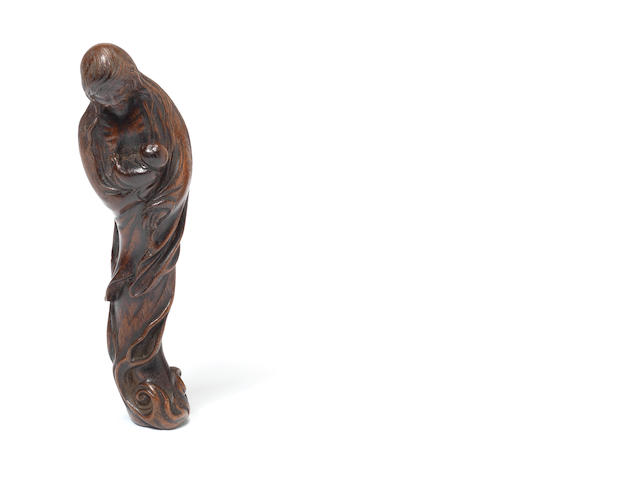 A wood netsuke of the ghost of Ubume, signed Masatoshi By Masatoshi, 19th century
